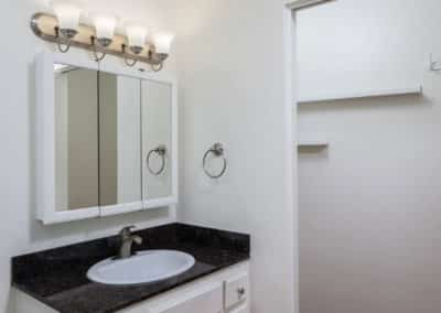 white bathroom wall with vanity