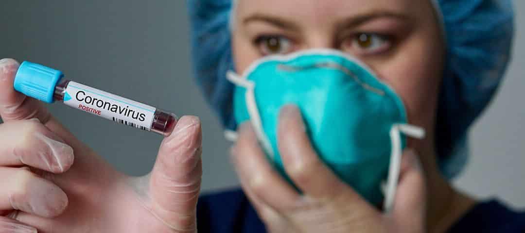doctor holding vial sample for coronavirus