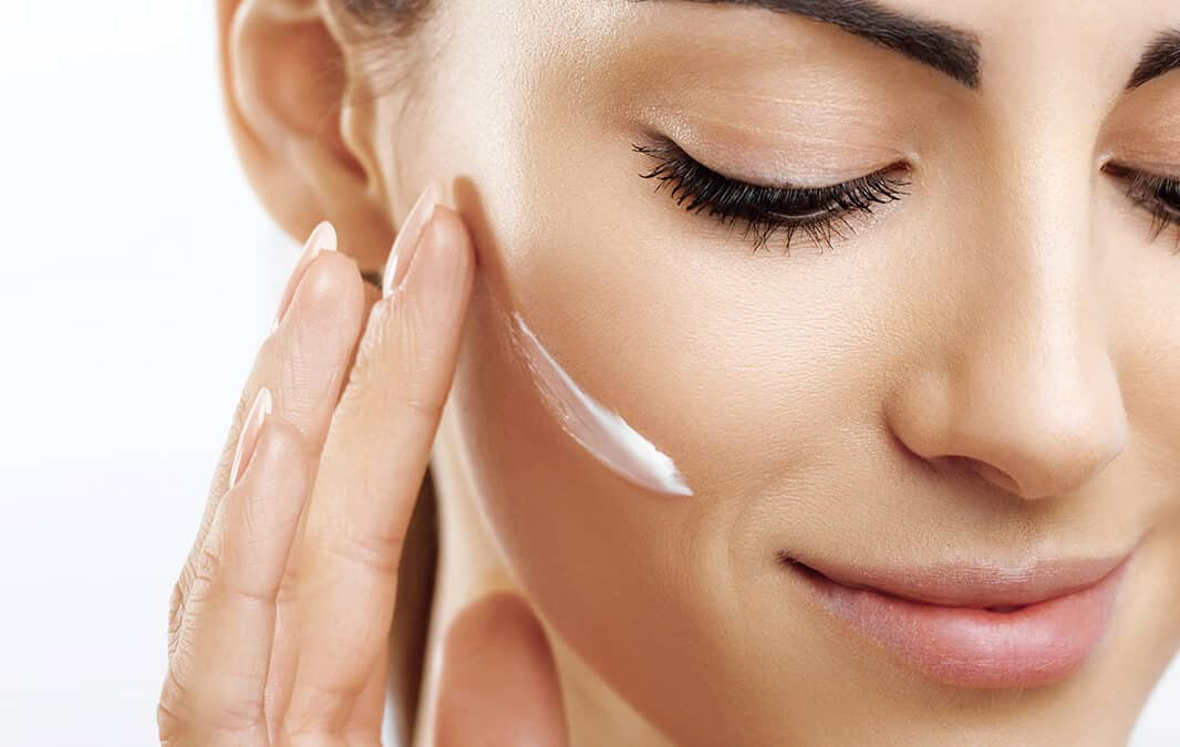woman applying a skincare product